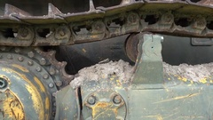 Dirty track of old bulldozer at parking Stock Footage