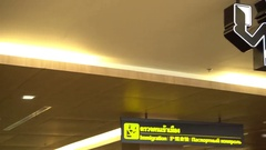 Airport interior immigration post Stock Footage