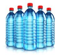 Group of blue plastic drink water bottles Stock Photos