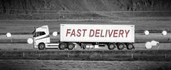Truck driving through a rural area - Fast delivery Stock Photos