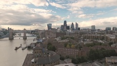 Aerial descending view of the skyline of the City of London with Tower bridge Stock Footage