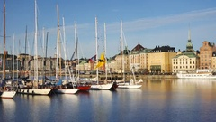 Stockholm city in summer, sailboats in foreground Stock Footage