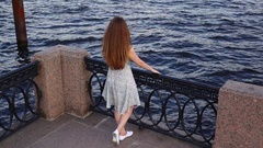 Brunette woman look to strong calm river water, old city area Stock Footage