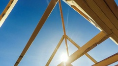 Construction site roof beams against blue sky Stock Footage