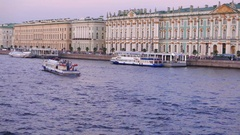 Neva river at Palace Embankment in twilight, touristic boats on calm water Stock Footage