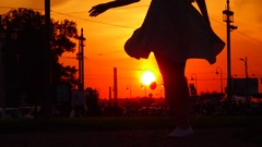 Dancing slim woman silhouette, cool skirt fly in air, slow motion Stock Footage