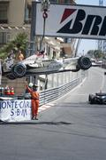 Formula 1 car being taken out of the race at Grand Prix of Monaco. Kuvituskuvat