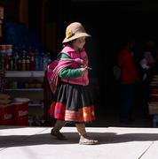 Peruvian girl dressed in colourful traditional handmade outfit. Stock Photos