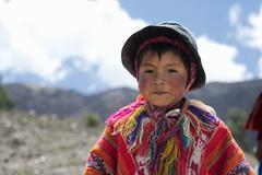 Portrait of a Peruvian boy dressed in colourful traditional handmade outfit. Stock Photos