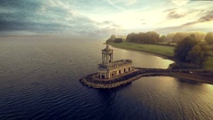Beautiful church in the lake, fly away shot. Aerial view Stock Footage