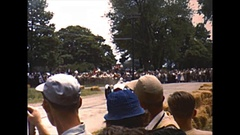 Vintage 16mm film, 1950, racing fans watch sports car race Stock Footage
