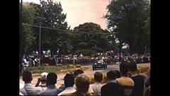 Vintage 16mm film, 1950, Bridgehampton sports car race, fans watch winner Stock Footage