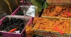 Panning view of a display of different variety of organic dried fruits Stock Footage