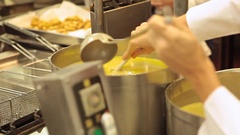 The chef is mixing soup in a professional kitchen Stock Footage