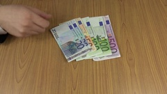 Man count euro cash money banknotes on table. 4K Stock Footage