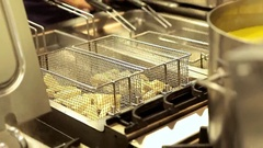 Fryers in a professional kitchen Stock Footage