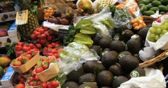 Panning view of a display of different variety of organic fruits Stock Footage