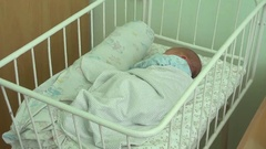 Newborn baby sleeps in a bed in the maternity hospital 1 Stock Footage