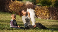 Young lady and boy with Maine Coon cat Stock Footage