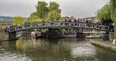 Time lapse view of people crossing a bridge over the canal at Camden town Stock Footage