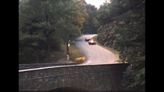 Vintage 16mm film, 1950 Watkins Glen race lap, stone bridge corner, ambulance Stock Footage