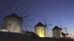 Sunset pan of the old windmills on the island of mykonos Stock Footage