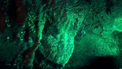 Inside a Cave with Water Drops on Stones and Green Light Stock Footage