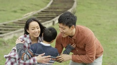 4K Portrait happy young Asian family spending time outdoors in the countryside Stock Footage
