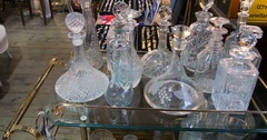 Display of vintage old-fashioned bottles at Portobello market in London Stock Footage