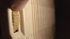 Turning an old radio receiving wire in the light bulb close-up Stock Footage