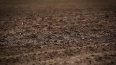 Camera slide over plowed ground Stock Footage