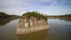 Jib shot of huge rock in scenic Mississippi River Stock Footage