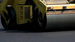 Asphalt roller of yellow color. Stock Footage
