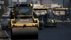 Asphalt roller on the road. Stock Footage