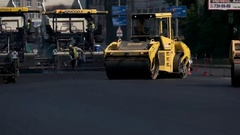 Yellow asphalt compactor. Stock Footage