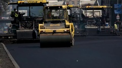 Asphalt compactor on road. Stock Footage