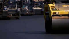 Yellow colored asphalt compactor. Stock Footage