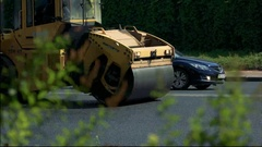 Side view of asphalt compactor. Stock Footage
