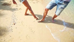 Girl Guy Feet Barefoot Draw Heart on Sand Beach at Wave Edge Stock Footage