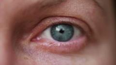Single blue female eye, close up Stock Footage