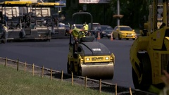 Vibratory rollers on the road. Stock Footage