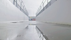 Puddle with Reflection on the Road Stock Footage