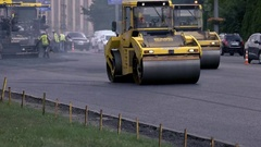 Vibratory compactors on the road. Stock Footage