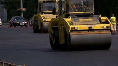 Vibratory rollers on road. Stock Footage