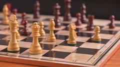 Chess game played on chessboard in stop motion film clip. Stock Footage