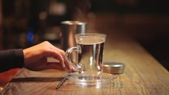 Boilign water glass in a bar Stock Footage