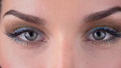 Woman blinking eyes Stock Footage