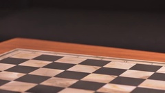 Chess pieces appearing on chessboard in stop motion film clip. Stock Footage