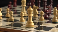 Chess pieces on chessboard with slow sliding motion. Stock Footage