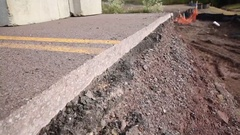 Road Closed! Closeup of Sliced Road Reveals Paved Layers and Dirt Stock Footage